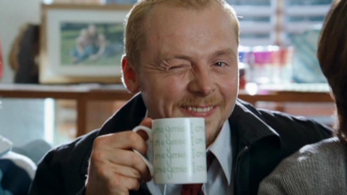 Simon Pegg holding a cup